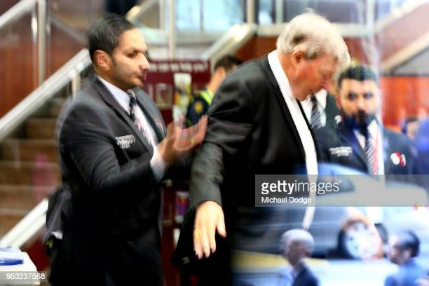 Cardinal George Pell is searched by security guards on arrival at Melbourne Magistrates' Court on May 1 2018 in Melbourne Australia Cardinal Pell was...