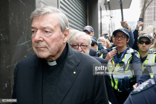 Cardinal George Pell leaves court with a heavy police guard in Melbourne on July 26 2017 in Melbourne Australia Cardinal Pell was charged on summons...