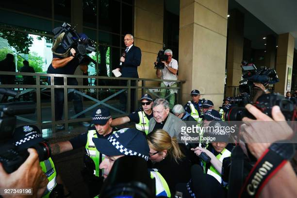 Cardinal George Pell leaves the Melbourne Magistrates' Court on March 5 2018 in Melbourne Australia Cardinal Pell was charged on summons by Victoria...