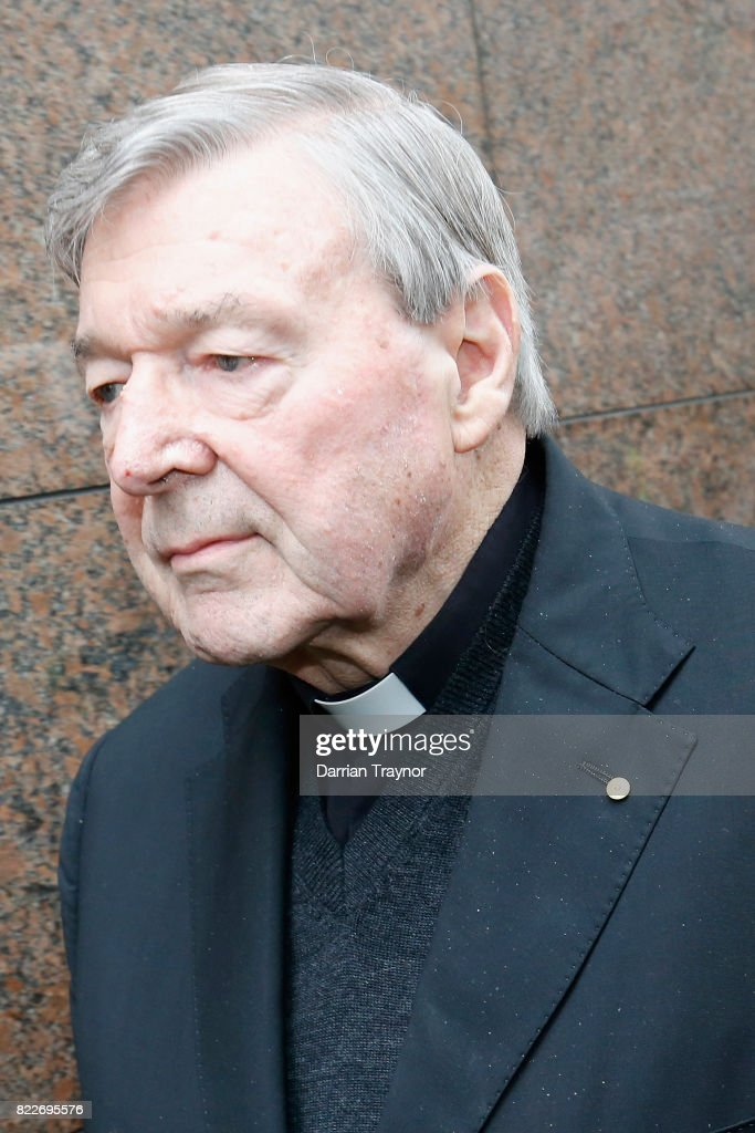 Cardinal George Pell leaves the Melbourne Magistrates Court with a heavy police guard in Melbourne on July 26, 2017 in Melbourne, Australia. Cardinal Pell was charged on summons by Victoria Police on 29 June over multiple allegations of sexual assault. Cardinal Pell is Australia's highest ranking Catholic and the third most senior Catholic at the Vatican, where he was responsible for the church's finances. Cardinal Pell has leave from his Vatican position while he defends the charges.
