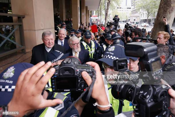 Cardinal George Pell leaves the Melbourne Magistrates' Court with a heavy Police escort on October 6 2017 in Melbourne Australia Cardinal Pell was...