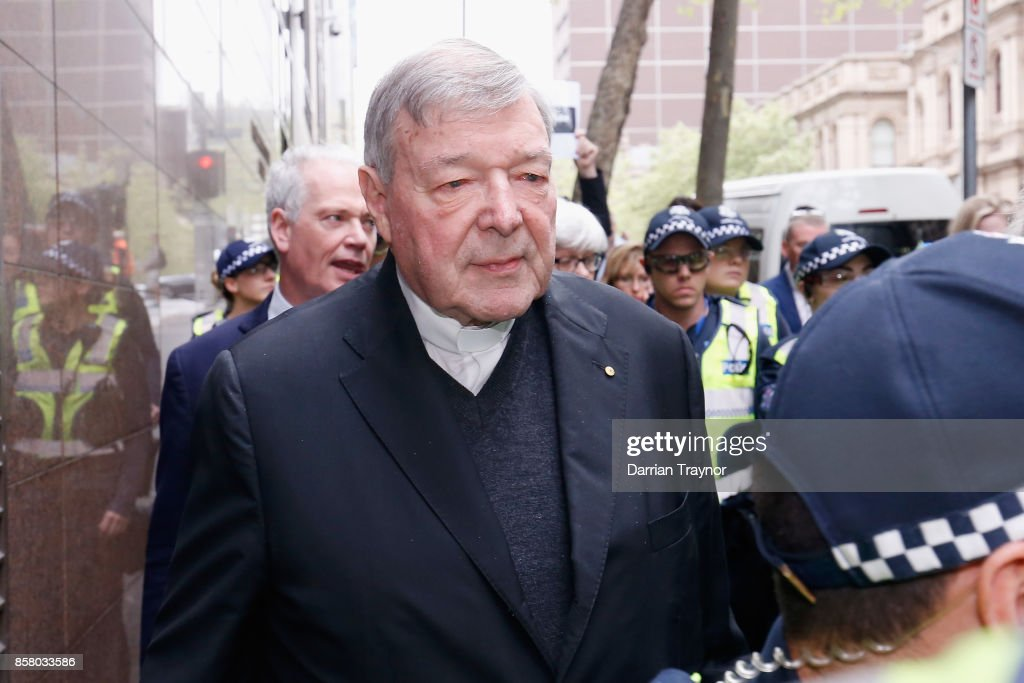 Cardinal George Pell leaves the Melbourne Magistrates' Court with a heavy Police escort on October 6, 2017 in Melbourne, Australia. Cardinal Pell was charged on summons by Victoria Police on 29 June over multiple allegations of sexual assault. Cardinal Pell is Australia's highest ranking Catholic and the third most senior Catholic at the Vatican, where he was responsible for the church's finances. Cardinal Pell has leave from his Vatican position while he defends the charges.