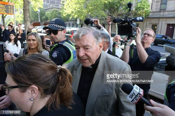 Cardinal George Pell makes his way through media as he arrives at court in Melbourne on February 27, 2019. - Cardinal George Pell arrived in court,...