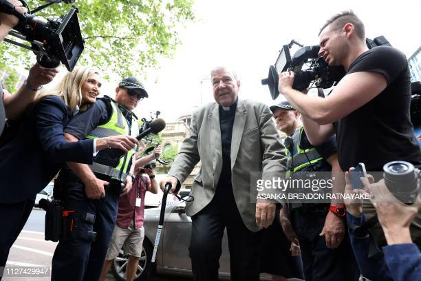 Cardinal George Pell walks from a car in Melbourne on February 26, 2019. - Pell is facing prosecution for historical child sexual offences.