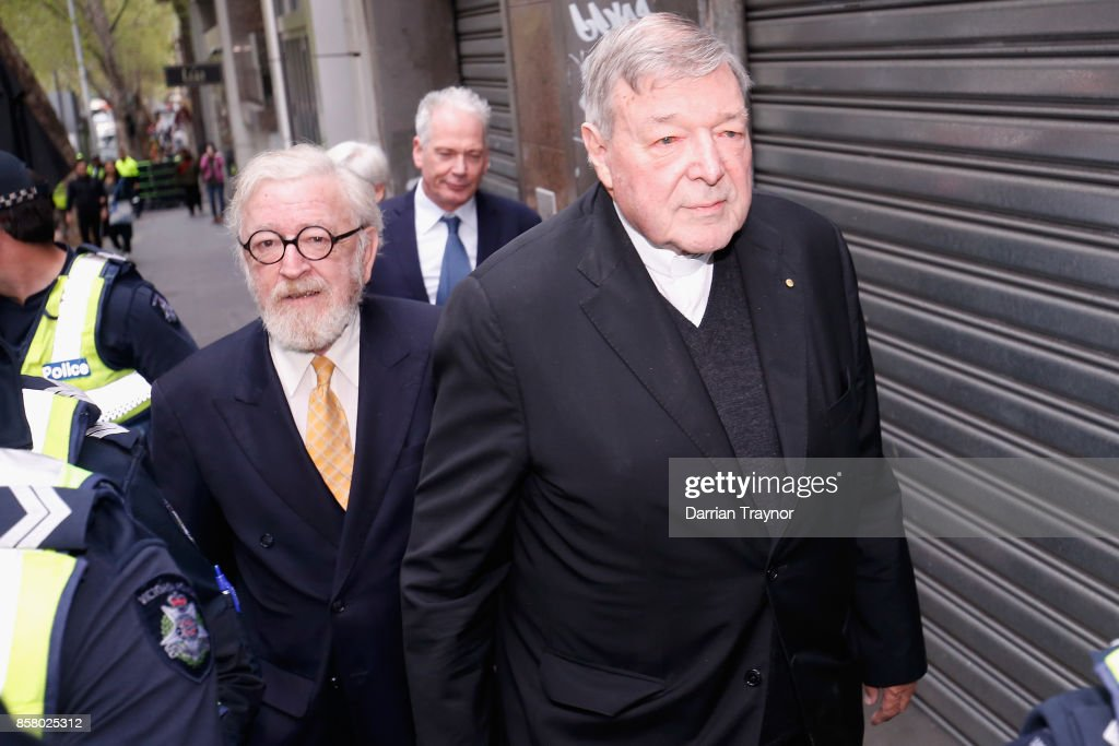 Cardinal George Pell walks from his lawyers office to the Melbourne Magistrates' Court on October 6, 2017 in Melbourne, Australia. Cardinal Pell was charged on summons by Victoria Police on 29 June over multiple allegations of sexual assault. Cardinal Pell is Australia's highest ranking Catholic and the third most senior Catholic at the Vatican, where he was responsible for the church's finances. Cardinal Pell has leave from his Vatican position while he defends the charges.