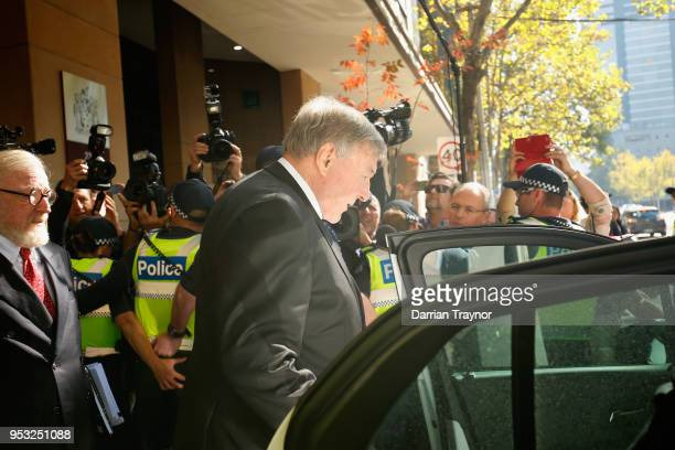 Cardinal George Pell walks through a police guard to a waiting car outside Melbourne Magistrates' Court on May 1 at Melbourne 1 2018 in Melbourne...