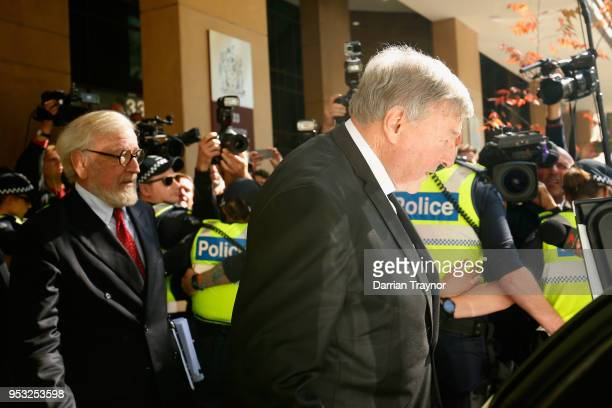 Cardinal George Pell walks through a police guard to waiting car outside Melbourne Magistrates' Court on May 1 at Melbourne 1 2018 in Melbourne...