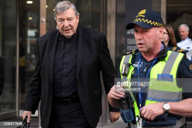 Cardinal George Pell walks to his car in Melbourne on September 20 2018 Pell is facing prosecution for historical child sexual offences