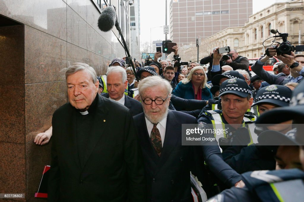 Cardinal George Pell walks with a heavy Police guard from the Melbourne Magistrates' Court on July 26, 2017 in Melbourne, Australia. Cardinal Pell was charged on summons by Victoria Police at Melbourne Magistrates' Court on July 26, 2017 in Melbourne, Australia. Cardinal George Pell was charged on summons by Victoria Police on 29 June over multiple allegations of sexual assault. Cardinal George Pell is Australia's highest ranking Catholic and the third most senior Catholic at the Vatican, where he was responsible for the church's finances. Cardinal George Pell has leave from his Vatican position while he defends the charges.