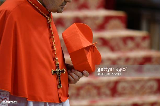 Cardinal holds his red three-cornered biretta hat before the start of a consistory for the creation of five new cardinals on June 28, 2017 at St...