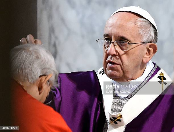 A cardinal is sprinkled with ashes by Pope Francis during the Ash Wednesday mass opening Lent the fortyday period of abstinence and deprivation for...