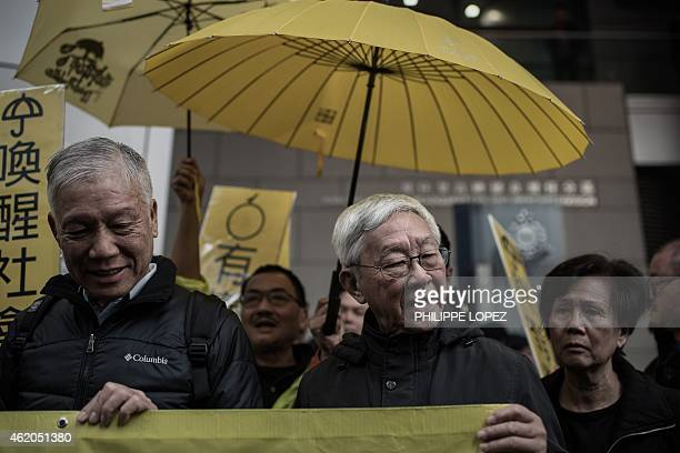 Cardinal Joseph Zen Ze-kiun , Hong Kong's outspoken former bishop, looks on as he joins leading pro-democracy activists in front of the Wanchai...