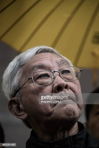 Cardinal Joseph Zen Ze-kiun, Hong Kong's outspoken former bishop, looks on as he joins leading pro-democracy activists in front of the Wanchai police...