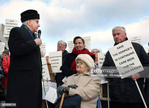 Cardinal Keith O'Brien leads a carol concert before petitioning MSPs on the future of St Margaret of Scotland hospice outside Scottish Parliament,...