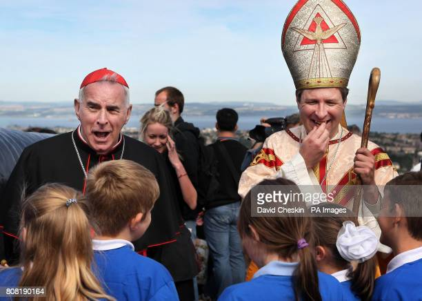 Cardinal Keith O'Brien talks to local children and Harry Schnitker dressed as St Ninian at Edinburgh Castle where he announced that there will be a...