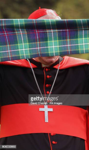 Cardinal Keith O'Brien unveils the worlds first Papal visit plaid the St Ninian's Day Tartan worn by a piper was presented to the Scottish parliament...