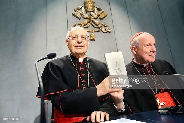 Cardinal Lorenzo Baldisseri and Cardinal Christoph Schonborn hold a copy of Pope Francis' post-synodal Apostolic Exhortation 'Amoris Laetitia' or...