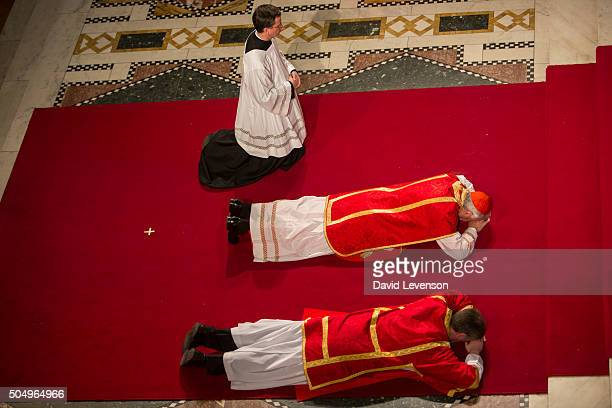 Cardinal Nichols prostrates himself before the altar at the Solemn Liturgy of the Passion of the Lord service at Westminster Cathedral on Good Friday...
