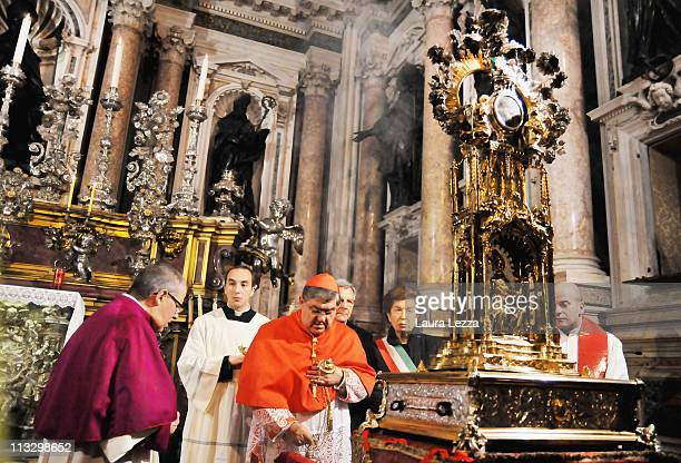 Cardinal of Naples Crescenzio Sepe stands close to the reliquary containing the two vials of the blood of San Gennaro before the ceremony on the...