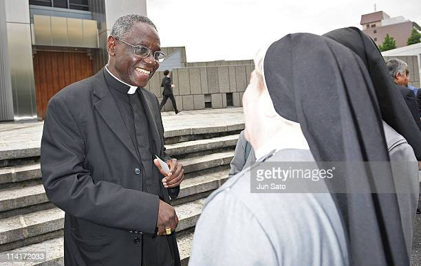 Cardinal Robert Sarah greets people outside after the Thanksgiving Mass For the Beatification of Pope John Paul II at St. Mary's Cathedral on May 14,...