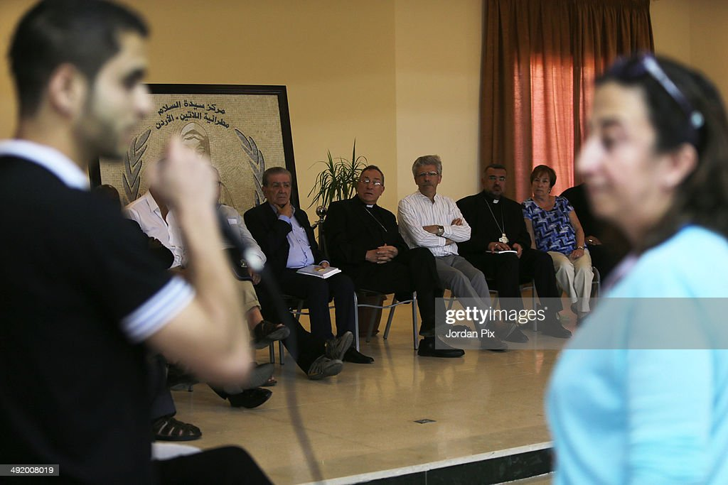 Cardinal Rodríguez Maradiaga of Honduras and President of the International Caritas, accompanied with forty personalities of the International Caritas meets with 400 Syrian refugees at the Caritas Jordan, on May 18, 2014 in Amman, Jordan. Pope Francis is scheduled to visit Jordan, Israeland the West Bank from May 24 - 26.