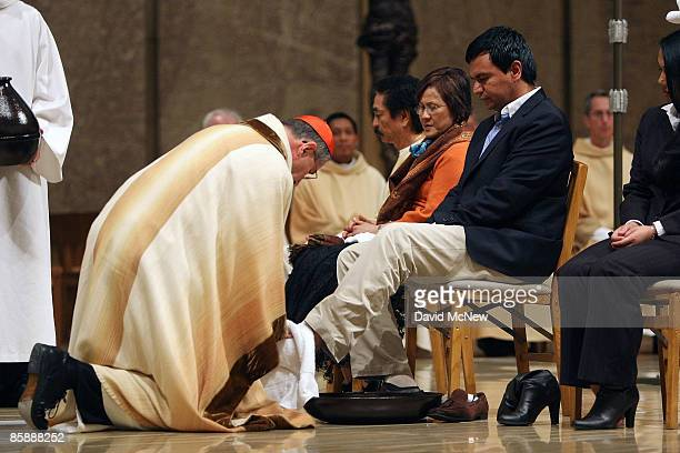 Cardinal Roger Mahony washes the feet of 12 people following the example of Jesus washing the feet of his 12 apostles during the celebration of the...