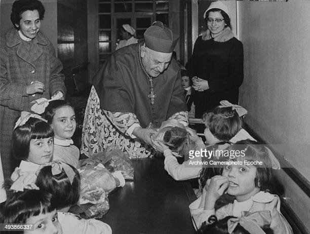 Cardinal Roncalli among children in a pediatric hospital