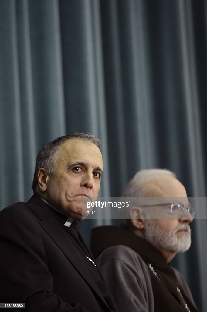 US cardinal Sean Patrick O'Malley (R) and US cardinal Daniel DiNardo listen during a press conference at the North American College on March 5, 2013 in Rome. The Vatican said Tuesday that the date for the conclave to elect a new pope could be set before all cardinals have arrived in Rome, as five electors were still missing from the roll call.