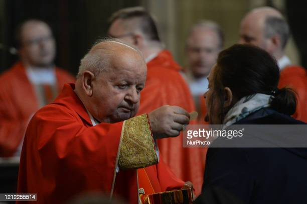 Cardinal Stanislaw Dziwisz distributes Holy Communion during the mass on the feast of Saint Stanislaus, bishop and martyr, the main patron of Poland,...