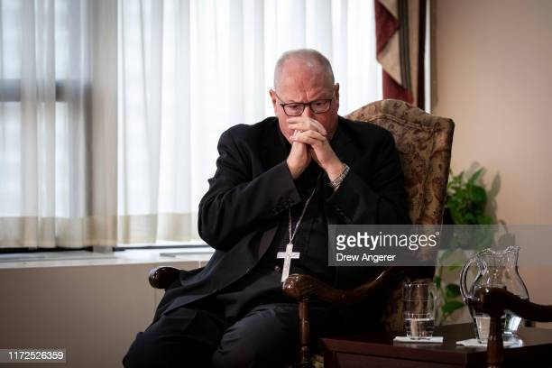 Cardinal Timothy Dolan, Archbishop of New York, attends a news conference regarding the response to sexual abuse of minors within the New York...