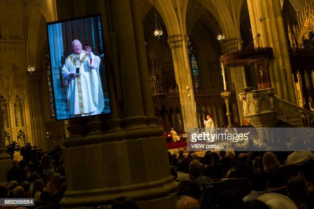 Cardinal Timothy Dolan arrives to St Patrick'u2019s Cathedral for mass while people take part in the Annual Easter parade on April 16 2017 in New...