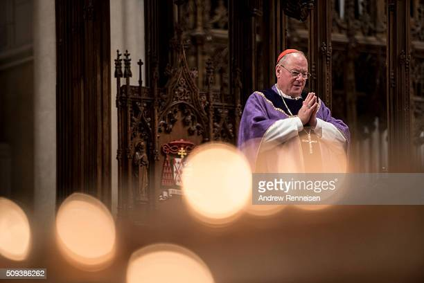 Cardinal Timothy Dolan holds mass on Ash Wednesday at St Patrick's Cathedral on February 10 2016 in New York City The day marks the start of the lent...