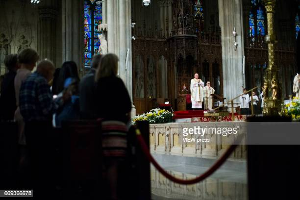 Cardinal Timothy Dolan presides mass at St Patrick'u2019s Cathedral during the Annual Easter parade on April 16 2017 in New York City The Easter...