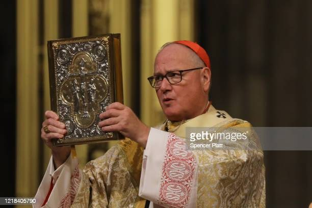 Cardinal Timothy Dolan, the Archbishop of New York, celebrates Easter Sunday Mass in a nearly empty St. Patrick's Cathedral as the coronavirus...