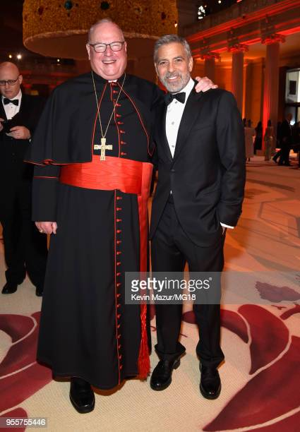 Cardinal Timothy Michael Dolan and George Clooney attend the Heavenly Bodies Fashion The Catholic Imagination Costume Institute Gala at The...