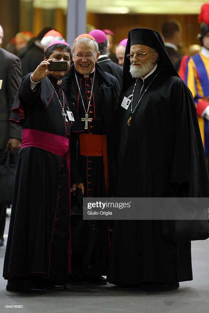 Cardinal Walter Kasper (C) and Patriarch Gregory III Laham (R) take a selfie with a bishop as they leave the closing session of the Synod on the themes of family the at Synod Hall on October 24, 2015 in Vatican City, Vatican. The final document has been welcomed by most as a carefully crafted work of art which seeks to balance the very different views and cultural perspectives of all Synod participants.