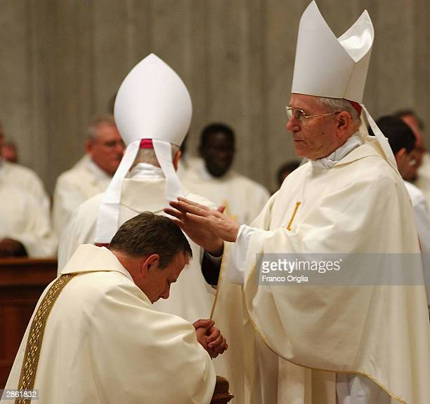 Cardinal Zeman Grochlewski appoints Rev J Michael Miller as Archbishop in Saint Peter's Basilica on January 12 2004 at Vatican City Pope John Paul II...