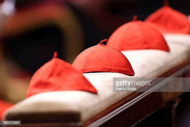 Cardinal's birettas are seen in St Peter's Basilica during a meeting of prayer at St Peter's Basilica with cardinals gathered in Rome for the conlave...