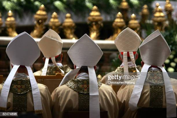 Cardinals face the altar as Colombian Cardinal Alfonso Lopez Trujillo gives the Mass of The Lords Supper in St Peter's Basilica March 24, 2005 in...