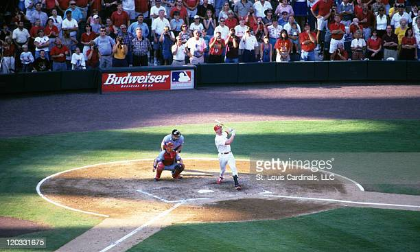 Cardinals first baseman Mark McGwire hits a home run during a game against the Montreal Expos at Busch Stadium on September 26 1998 in St Louis...