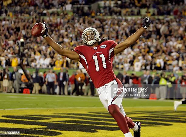 Cardinals Larry Fitzgerald celebrates after his touchdown catch in the fourth quarter as the Pittsburgh Steelers face the Arizona Cardinals in Super...