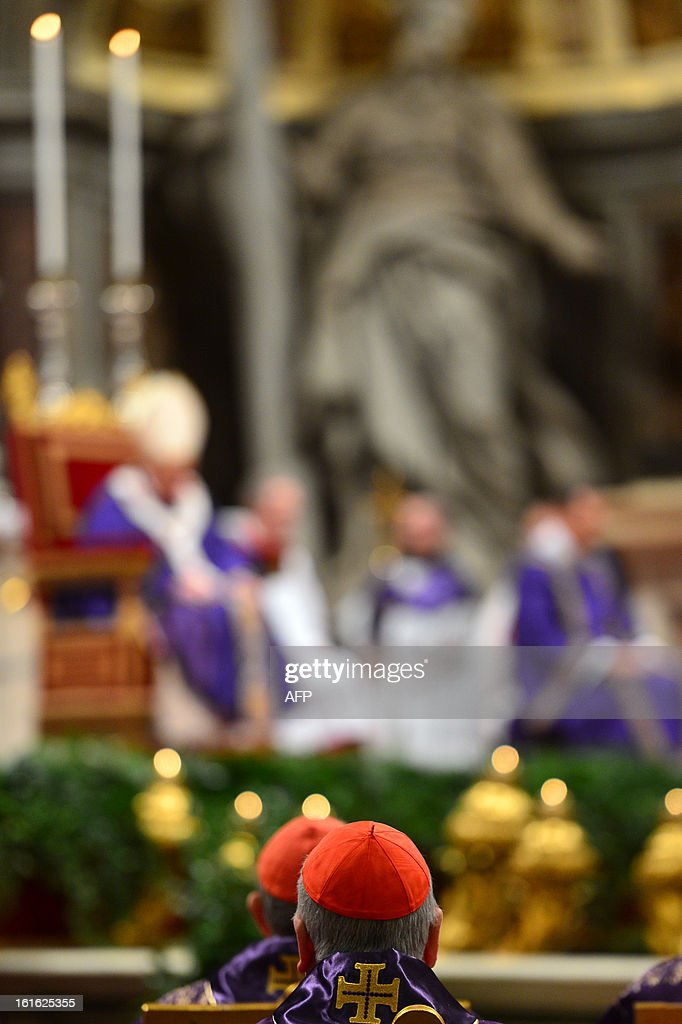 Cardinals look at Pope Benedict XVI leading the mass for Ash Wednesday, opening Lent, the forty-day period of abstinence and deprivation for the Christians, before the Holy Week and Easter, on Febr...