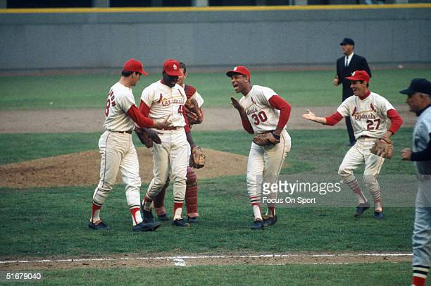 Cardinals pitcher Bob Gibson is congratulated by teammates Mike Shannon Orlando Cepeda and Dal Maxville at Busch Stadium in St Louis Missouri in 1967