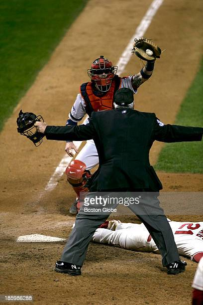 Cardinals player Allen Craig is called safe at home plate from an obstruction call in the ninth inning during Game Three of the 2013 Major League...
