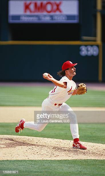Cardinals relief pitcher Dennis Eckersley delivers a pitch during a game against the Cincinnati Reds at Busch Stadium on June 22 1997 in St Louis...