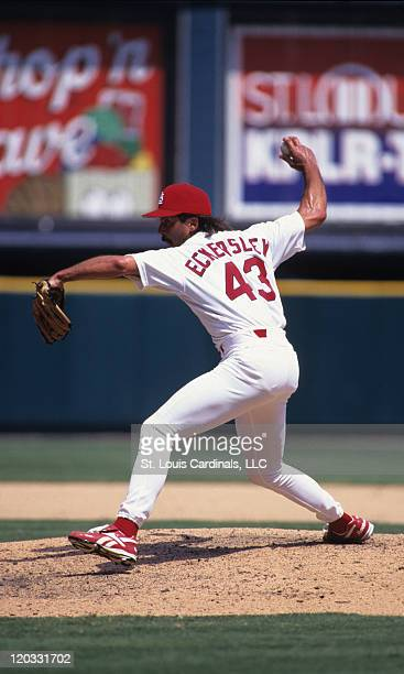 Cardinals relief pitcher Dennis Eckersley delivers a pitch during a game versus the Florida Marlins at Busch Stadium on July 26 1997 in St Louis...