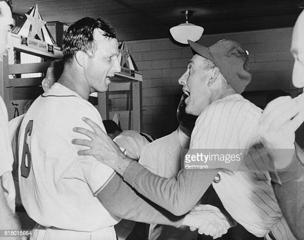 Cardinal's Stan Musial who poled the winning homer to break the tie in the 12th inning of the 22nd AllStar Game gets the glad hand from Mayo Smith...