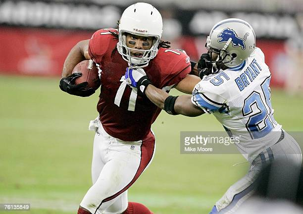 Cardinals wide receiver Larry Fitzgerald fight off the Lions corner back Fernando Bryant after a catch during first half action of the Cardinals...