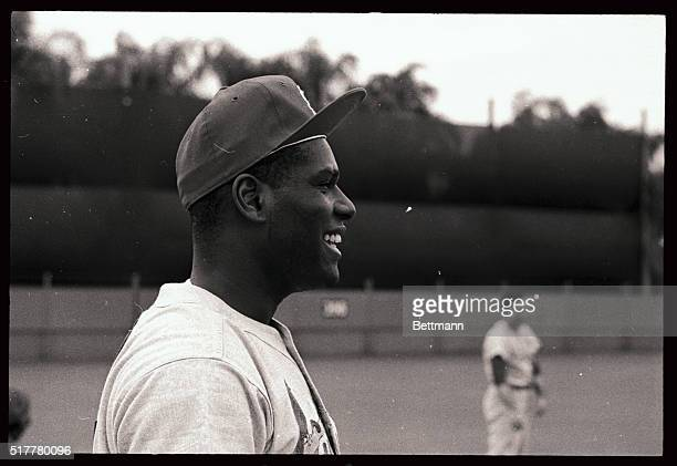 Cardinals' World Series winning pitcher Bob Gibson seems to find one exercise routine to his liking as he flashes a grin The cards opened spring...
