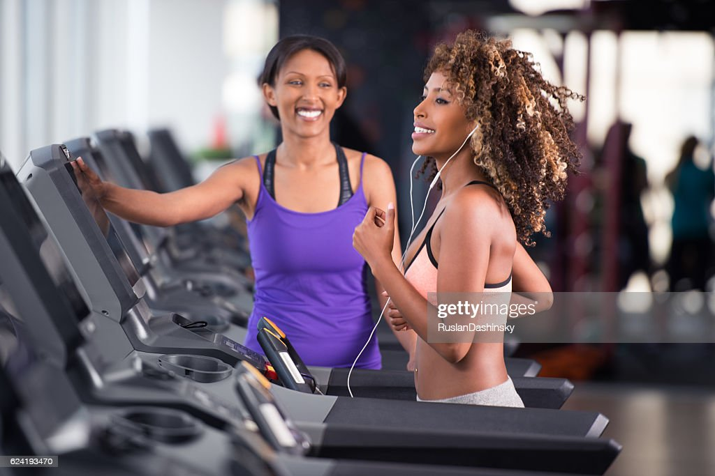 Cardio workout with personal training. : Stock Photo
